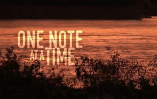 one note at a time movie title image