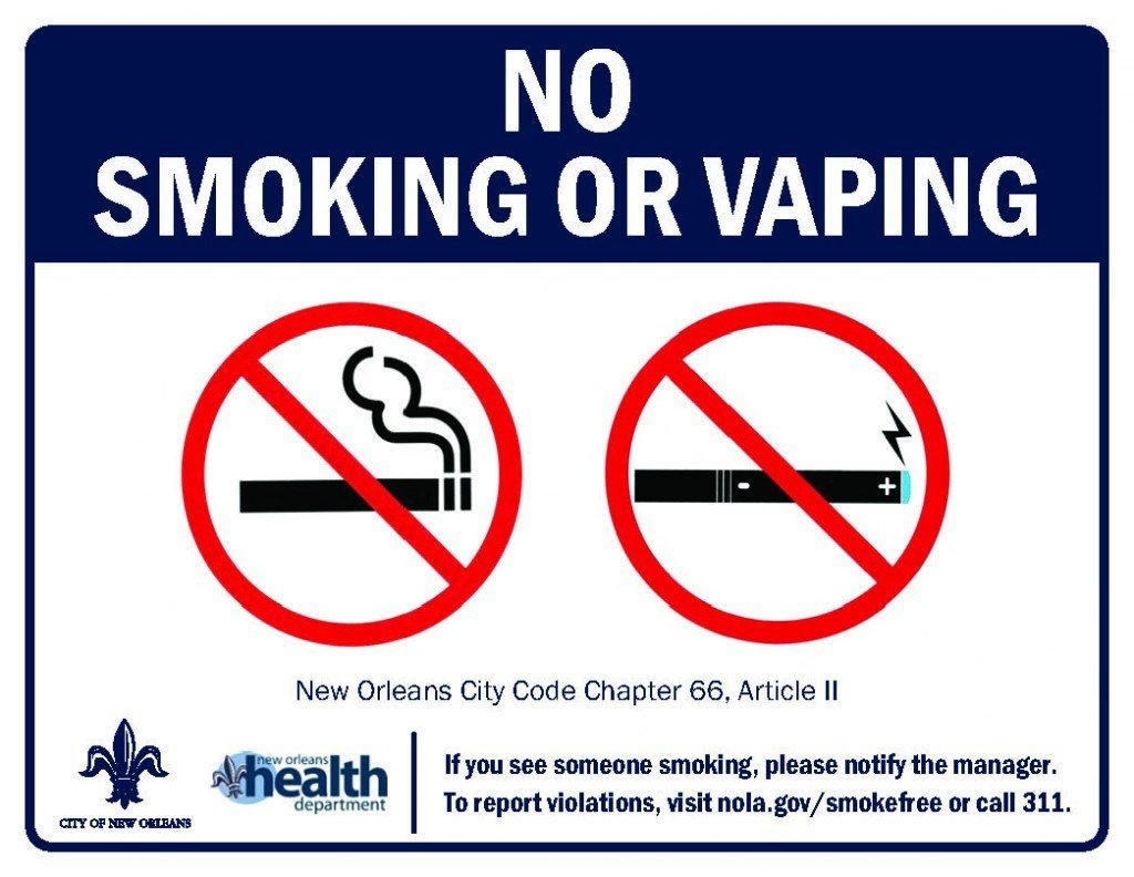 No Smoking or Vaping sign. New Orleans City Code Chapter 66, Article II. If you see someone smoking, please notify the manager. To report violations, visit nola.gov/smokefree or call 311.